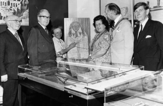 The opening of the Wellcome Museum in the Classics Department. Right to left: Harry James, the Mayor and Mayoress of Swansea, Kate Bosse-Griffiths, Principal Steel, Gwyn Griffiths.